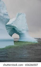 Huge iceberg with window in Antarctica