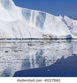 Huge icebergs of Greenland.Travel on the scientific vessel among ices. Studying of a phenomenon of global warming. Deep-water fjords with clear water.