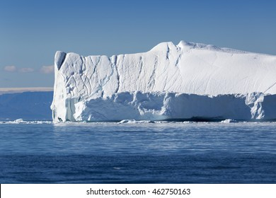 Huge icebergs.Travel on the scientific vessel among ices. Studying of a phenomenon of global warming. Importance of preservation of ecological balance. Deep-water fjords with clear water.