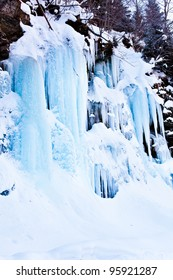 Huge icicles formed in a waterfall on a mountain
