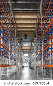 Huge industrial empty warehouse with steel constructions
