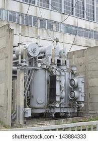 Huge industrial high-voltage substation power transformer on rails at power plant