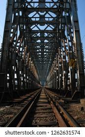 Huge industrial metal bridge for cargo railway in perspective