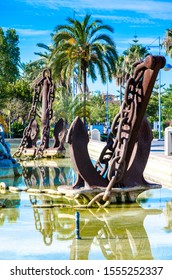 huge Large old ship anchor as a park decoration with a large fountain, iron scrap from an old ship, use as a fountain decoration, Spanish design, an old screeching ship chain, water in tank, blue sky