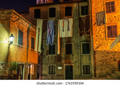 Huge Laundry on the squre of Old Town in Kotor at night, Montenegro