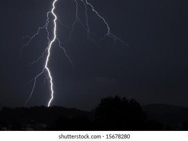 Huge lightning bolt striking in Beskydy mountains, Czech Republic