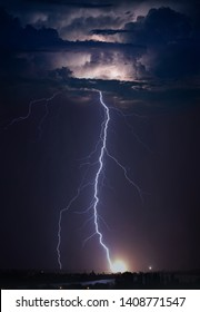 Huge lightning in dark stormy sky, climate change and weather forecast concept