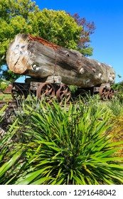 A Huge Log on an Old Rail Trolley. Kauri Logs Like These Were Once Harvested in New Zealand. This Relic of That Bygone Industry is in a Park in Katikati, NZ