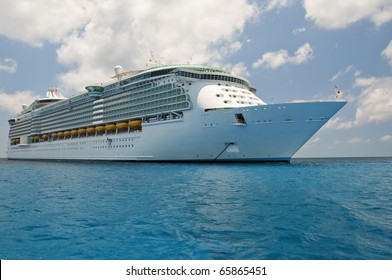 huge luxury cruise ship anchored in blue caribbean waters