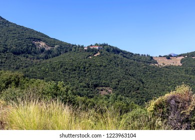 """A huge, majestic mountain in the summer on a sunny day and orthodox, christian monastery of """"Agia Lavra"""" near Kalavryta (Achaea, Greece, Peloponnese)."""