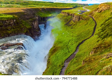 Huge masses of water crash into a narrow gorge. The waterfall in Iceland - Gullfoss on the Hvitau River. The concept of extreme and phototourism