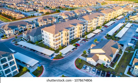 Huge massive Apartment townhome complex multistory building in North Austin , Texas , USA at sunset with golden hour colors on huge building at new development real estate living area in the suburbs