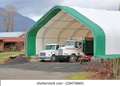 A huge mesh and rod canopy provides weather protection for large vehicles including semi trailer rigs.