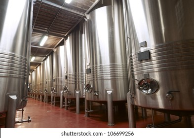 huge metal reservoirs for the fermentation of wine