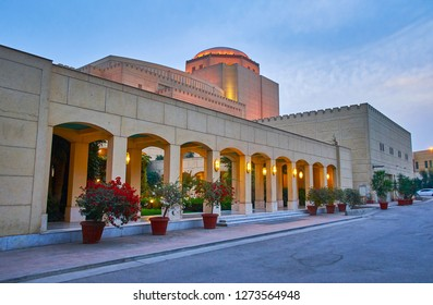 The huge modern building of Cairo Opera House is decorated with column gallery, Arabic lights and blooming plants in pots, National Cultural Centre, Gezira Island, Egypt.