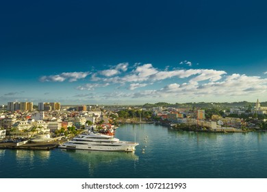 Huge motor boat in the port of Pointe-a-Pitre, with beautiful city on background Guadeloupe