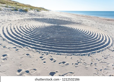 huge mysterious abstract circles on the sand of a beach