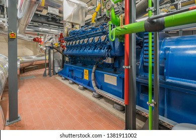 a huge natural gas engine works in a combined heat and power plant and supplies a district with heat
