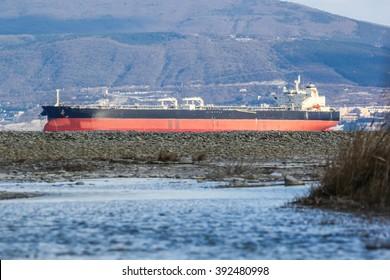 Huge oil tanker entering the port of Novorossiysk for loading