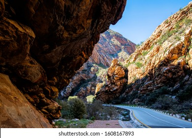 A huge overhang of rock by a road through a maountain pass in Meiringspoort, South Africa