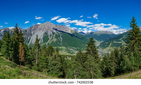 Huge panoramic view of Bormio village and alps mountains