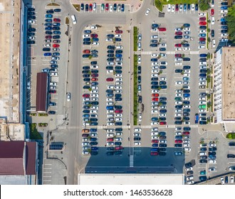 huge Parking lot in center of the business district, top view from the drone with car parking around as sense of community and neighborhood