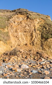 Huge pile of rock fallen from a cliff due to coastal erosion