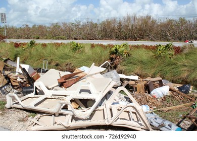 Huge piles of garbage and debris patio chair in the streets aftermath of Hurricane Irma flooding and tidal wave in Islamorada in the florida Keys