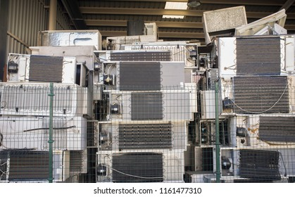 Huge piles of refrigerators stacked at recycling plant. Low angle view