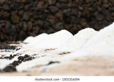 Huge piles of salt in the Salinas de Fuencaliente, La Palma, Spain with focus on the second pile.