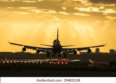 Huge plane is landing on the runway.