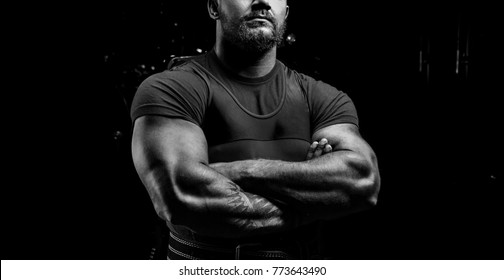 Huge powerlifter stands in front of the camera and strains his huge hands. Mixed media