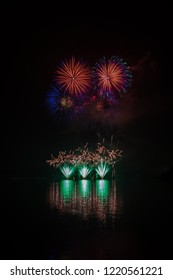 Huge, rich and colorful fireworks over surface of Brno's Dam with reflection on the surface of lake