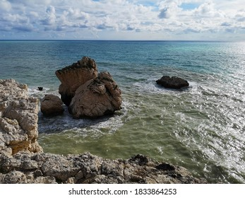 Huge rock formations on the shore of Mediterranean Sea, Cyprus. Petra tou Roumiou Beach.