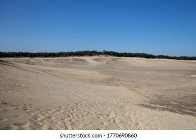 Huge sand dune. Interesting nature landscape, man versus environment. Nature wonder in Slovakia.