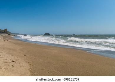 A huge sandy beach with large stones. Sonoma Coast State Park, California, USA