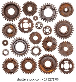 A huge set of rusty metal gears isolated on a white background.