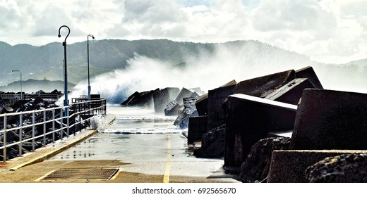 Huge seven-meter seas breaking over the Coffs Harbour Marina break-wall during a savage winter sea storm.   Photographed at Coffs Harbour, New South Wales, Australia.
