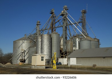 Huge silos on farm situated right next to railroad tracks for transporting grains