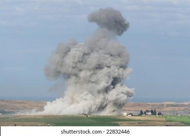 huge smoke of explosion in Gaza. morning light.