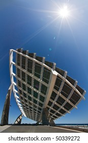 """A huge solar panel under the sun rays. It's located in the """"forum"""" area of Barcelona."""