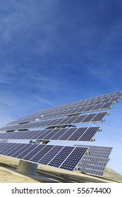 huge solar panels and blue sky with clouds