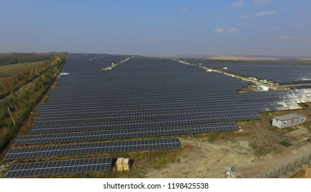 Huge solar power station with hundreds of megawatts near town Kamianets-Podilsky (Ukraine), aerial autumn view. Usage of solar energy. Solar panels and battery. solar energy industry