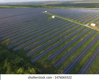 Huge solar power station with hundreds of megawatts near town Kamianets-Podilsky (Ukraine), aerial summer view. Usage of solar energy. Solar panels and battery, modern progressive industry.