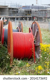 Huge spools  with  cables for the construction industry to connect new built houses
