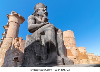 The huge statue of Ramesses II in Luxor Temple, Egypt, a large Ancient Egyptian temple complex located on the east bank of the Nile River in the city today known as Luxor (ancient Thebes).