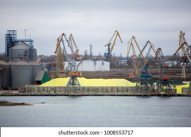 Huge stockpile of industrial sulfur that will be shipped around world. Industrial Sulfur Stockyard and Pile. Huge stockpile of sulfur in sea port at bulk cargo port terminal
