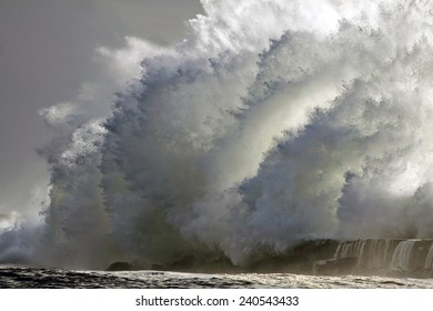 Huge stormy wave over mouth of river Ave pier, Vila do Conde, north of Portugal