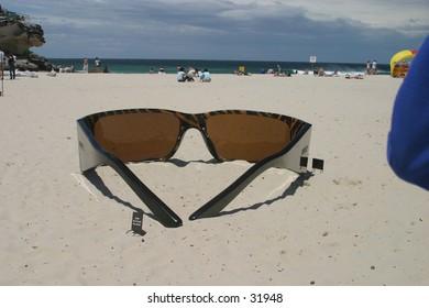Huge Sunglass on the sandy beach