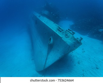 A huge sunken abandoned ship at a depth of 30 meters in crystal clear water. Grand Cayman.